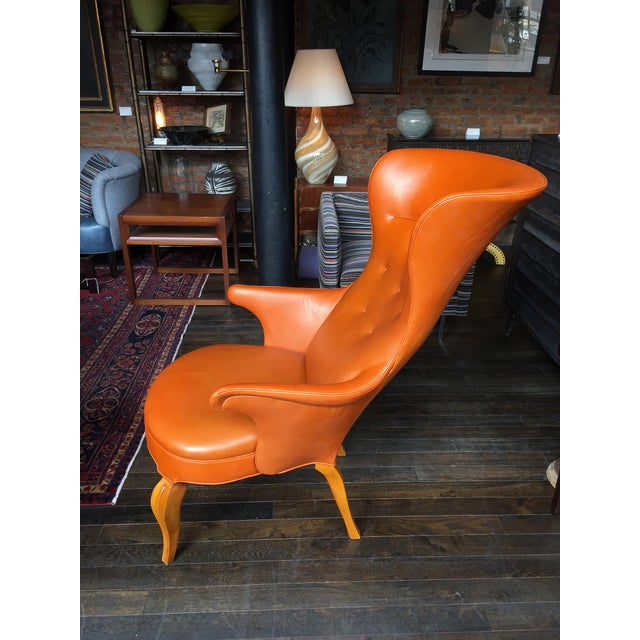 This exceptional high wingback armchair is attributed to Danish designer Frits Henningsen (1899-1965). Henningsen was...