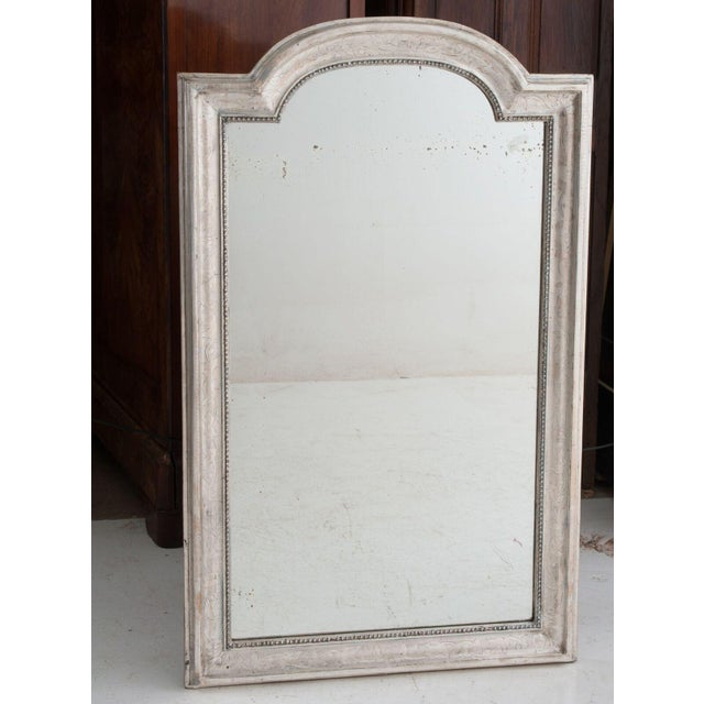 French Louis Philippe large silver gilt mirror with a lightly etched motif of flowers, pearl banding surrounds the...