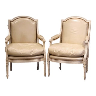 Pair of French Louis XVI Carved Painted Armchairs With Beige Leather Upholstery For Sale