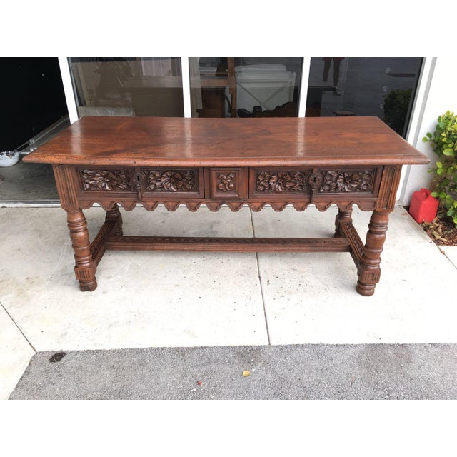 17th Century Spanish Baroque Carved Walnut, Refectory Console Table A Spanish Baroque walnut table. The rectangular top...