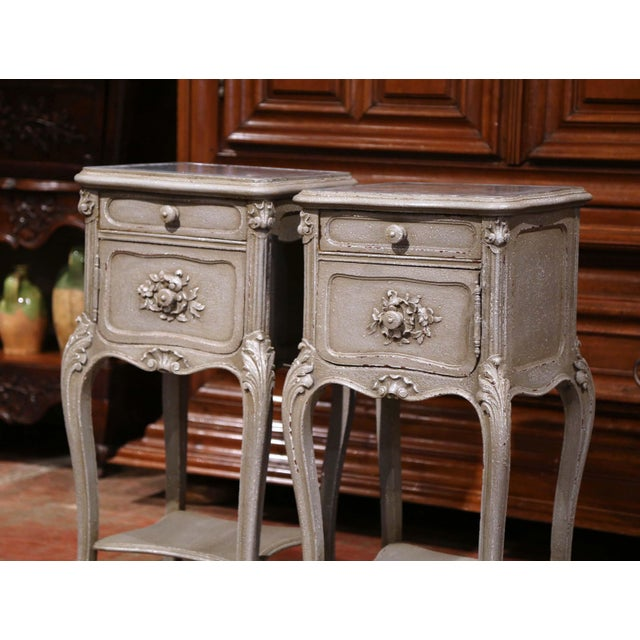 Complete your bedroom with this elegant pair of antique bedside tables from France, crafted, circa 1880. The tables are...