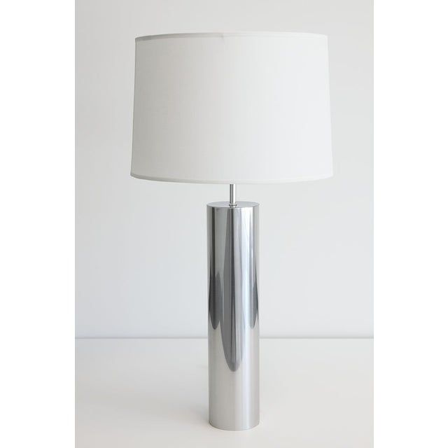 A vintage 1970s Nessen steel cylinder table lamp. This minimalist lamp features a pure reflective cylindrical design. The...