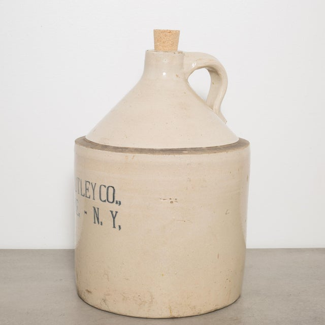 ABOUT This is an original salt glazed stoneware jug with handle by R.L. Utley Company. This piece has retained its...