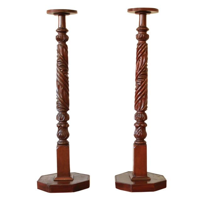 Offering a gorgeous pair of 19th-century carved mahogany plant stands. The stands are solid and sturdy and display...
