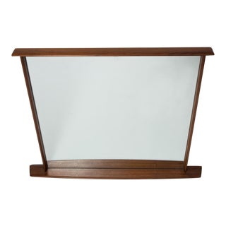 George Nakashima mirror with sculpted walnut frame, mfg. Widdicomb