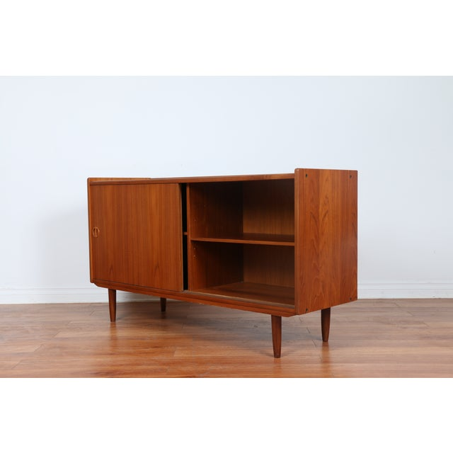 Vintage early 1960s Teak Shelving Credenza. Refinished. Teak in perfect, well kept condition. Shelves inside, no damages...