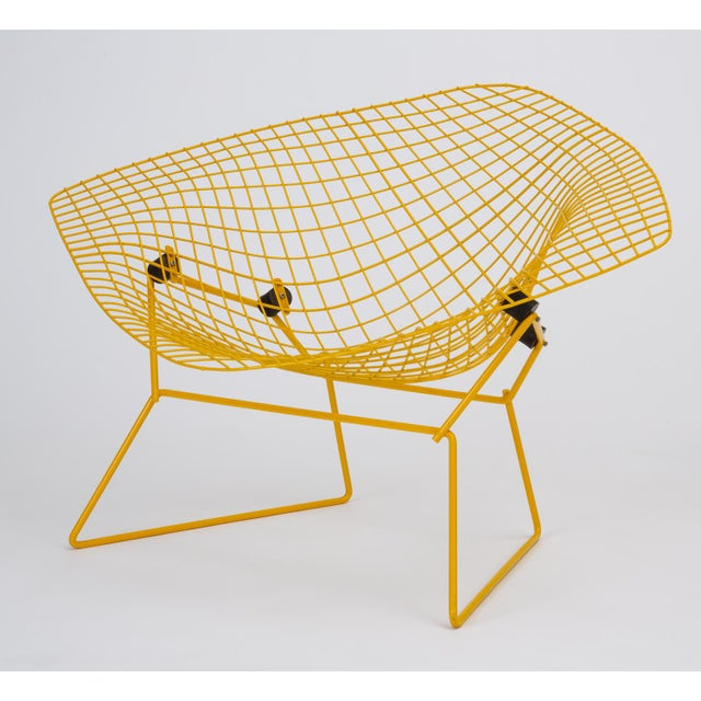 A wide lounge chair by Harry Bertoia for Knoll Associates. This example is the shock-mounted version that acts as a...