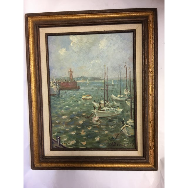 A beautiful impressionistic painting by Ukrainian American artist Ivan Denysenko of a Harbor Scene with boats and hills in...
