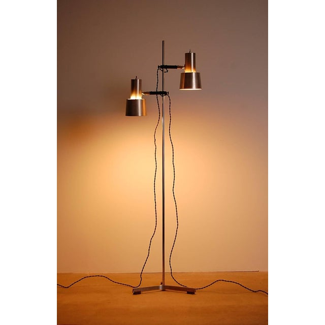 Floor lamp in stainless steel and teak by Fog and Mørup, circa 1966. Designed by Jo Hammerborg. Consists of two shades...