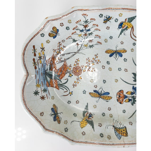 We are selling this nice polychrome Faience platter. This platter is decorated with great Chinoiserie style decoration of...