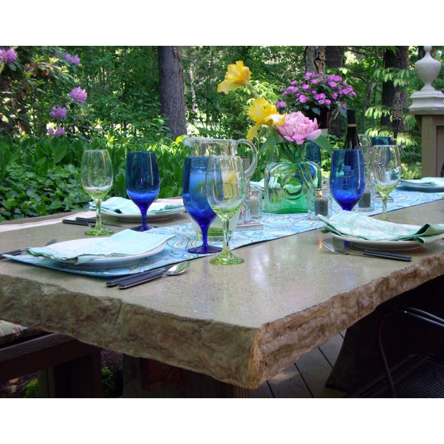 """This is a great dining table for your deck or patio. The table features a cast concrete rock edge table top measuring 84""""..."""