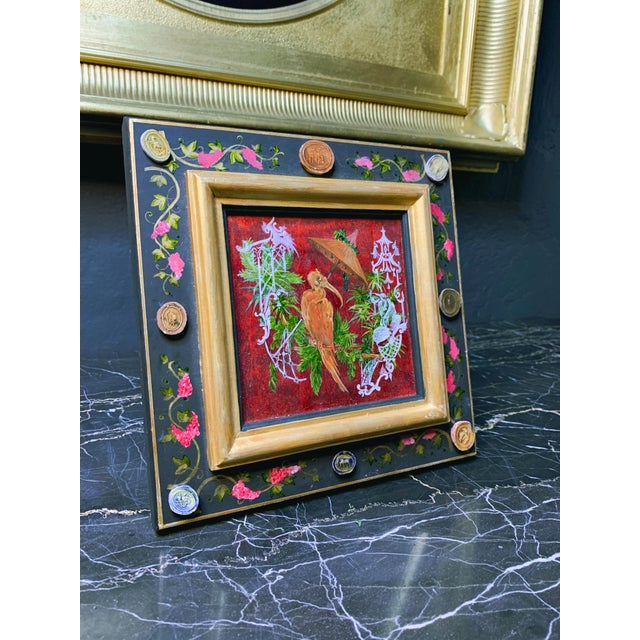 By Vramyan Interiors, wall hanging, a hand-painted wood panel with crane painting, and rare cameos around the border. The...