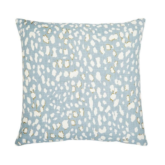 Blue and white animal printed linen pillow. Back is same as front. 95% Feather 5% Down Insert. Made in the USA.