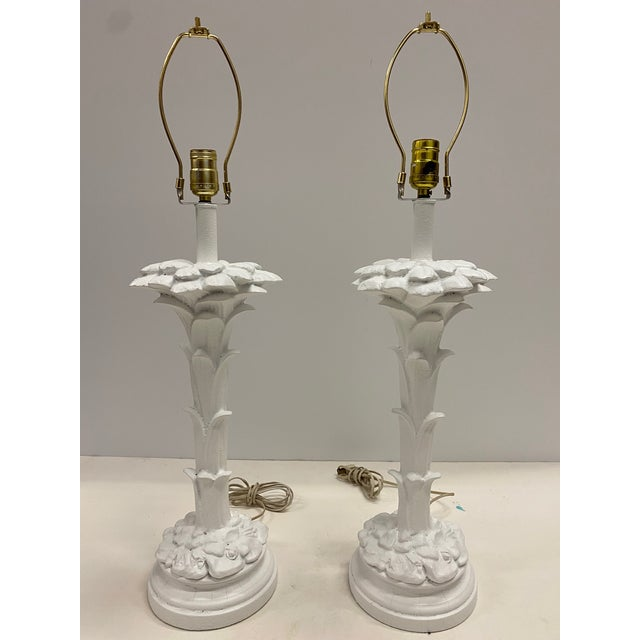 Glam pair of Hollywood Regency painted white plaster palm tree motife table lamps in the style of Serge Roche. Measures:...