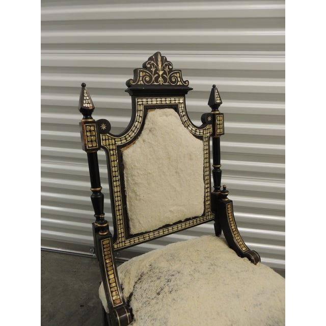 Vintage Moroccan mother-of-pearl inlaid frame and ebonized wood. One-of-the-kind slipper chair, with original wool and...