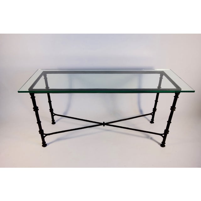 A fantastic Giacometti style wrought iron console table. ht: 31.75, Width: 60, Depth: 20