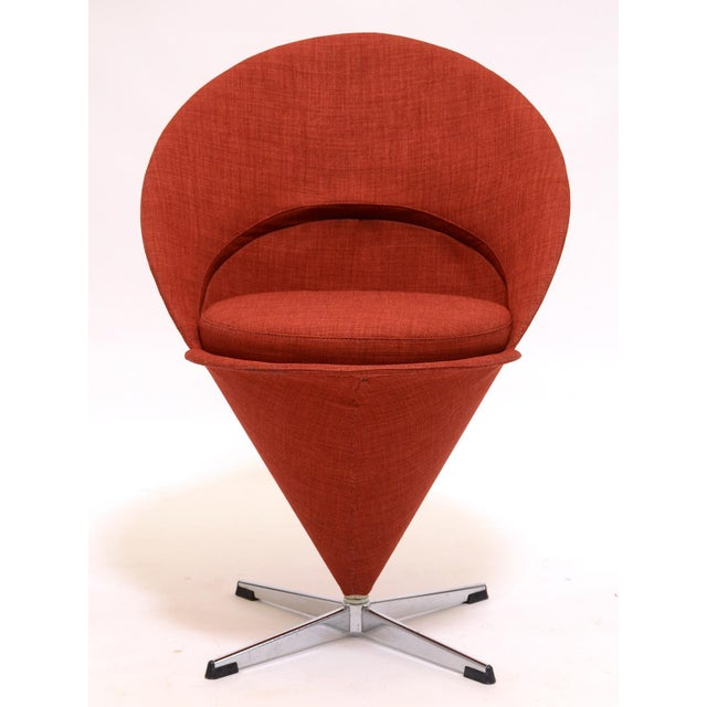 A classic Panton design, the cone chair is petite, sculptural, playful and surprisingly comfortable. This vintage example...