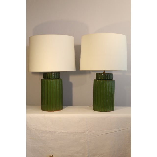 A pair of transitional style ceramic table lamps. Reeded design. Beautiful asparagus color. inherent to the 1940s 50'sand...