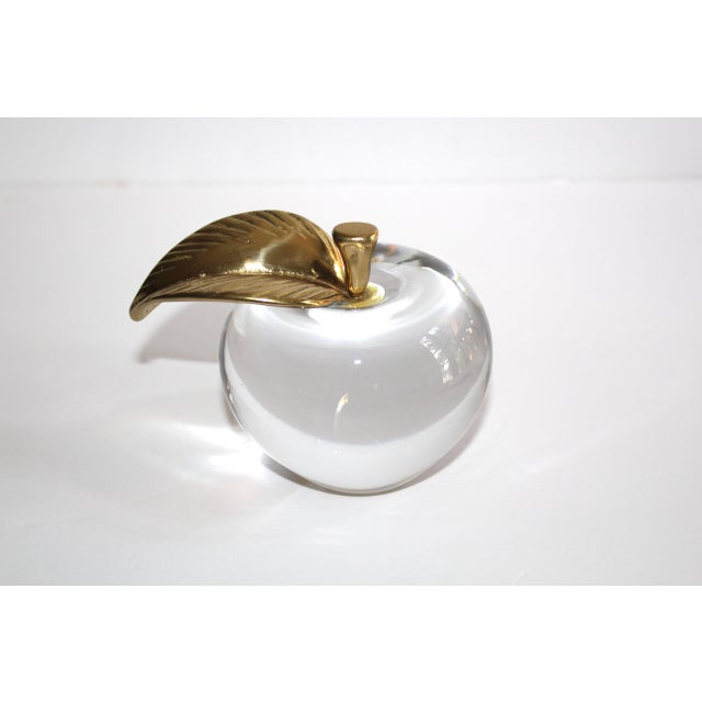 Mid-century modern blown glass paperweight in the form of an apple. Sculptural apple features a stylized stem with leaf in...