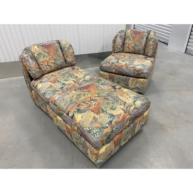 Two wonderful chairs and ottoman by Henredon. Beautiful palm floral fabric. Chairs and ottoman can be utilized in many...