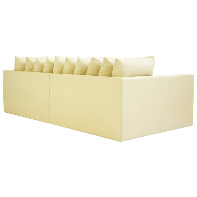 This Joe D'urso Knoll sofa was produced in all leather in an off white, light yellow color. 10 pillows are down filled,...