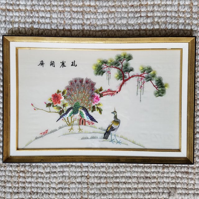 Vintage Mid Century silk embroidered framed art with peacocks. Exquisite detail and character with this unique piece!