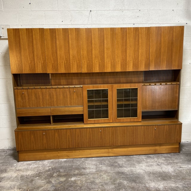 Fantastically preserved light rosewood veneer modular wall unit. Consists of three horizontal pieces that stack easily and...