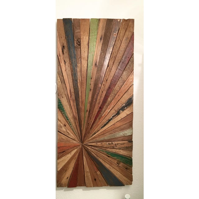 Stunning solid wood slabs comprising a sunburst with light vintage style painting. Heavy, natural, eye catching,...