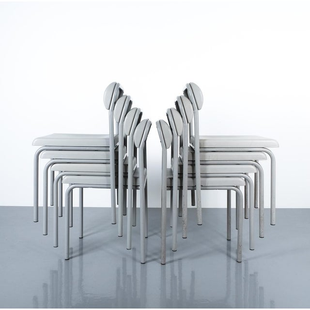 One of Seven Ettore Sottsass Greek Chairs Grey Bieffeplast, Italy, 1980. Light grey chairs made from lacquered tubular...