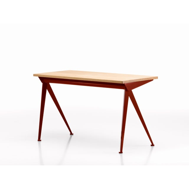 Jean Prouvé compas direction desk in natural oak and Japanese red metal for Vitra. Originally designed in 1953, Prouvé's...