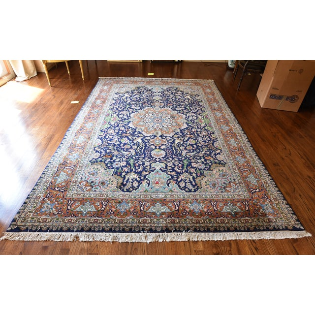 Stunning Iranian Tabriz dating to the 1950's made of wool and silk. Gorgeous patterns and colors on dominate blue...