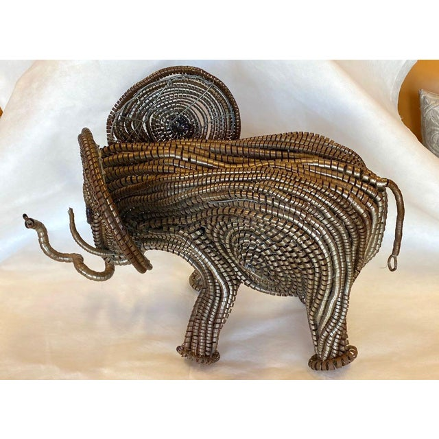 Wonderful Mid-Century matériaux trouvé elephant. T he artist repurposed industrial steel coil into an artistic medium, and...