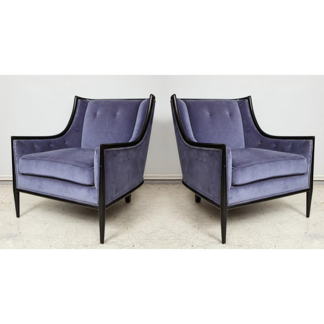 Pair of Mid-Century Modern ebonized armchairs with lavender upholstery.