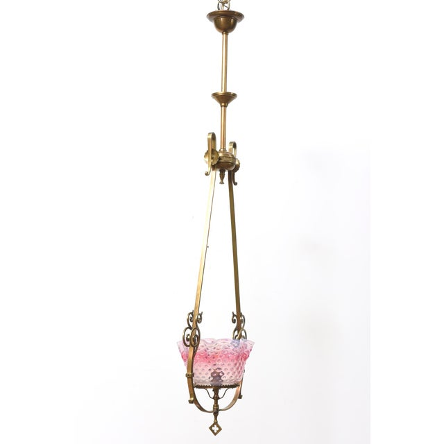Brass lantern fixture with ruffled pink hobnail glass. Originally gas. Single bulb. Completely restored and rewired....