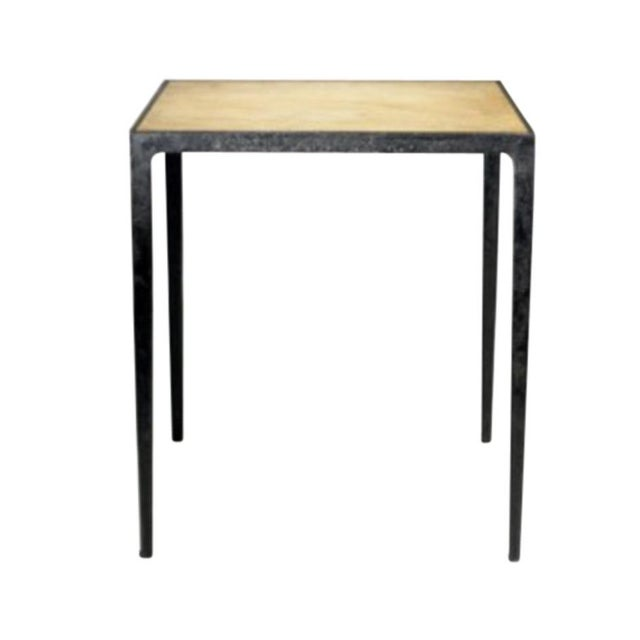 """The """"JMF"""" Iron and Parchment Occasional Table."""