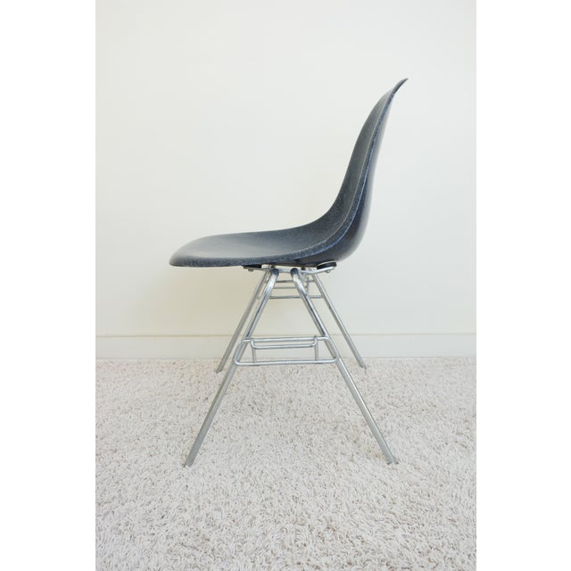 A vintage fiberglass Eames shell chair with stacking base/legs. Excellent condition, especially for it's age, with no...