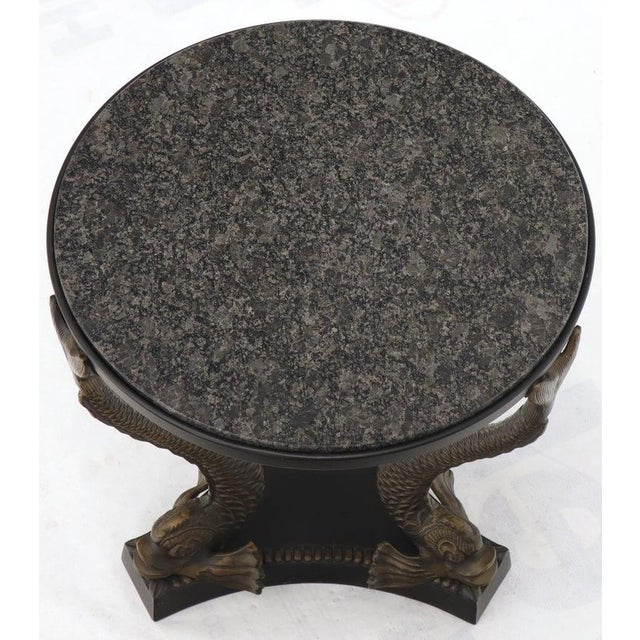 Decorative bronze side end occasional round table with granite top.