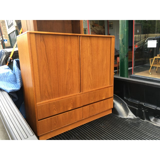 This is a gorgeous teak dresser by Jesper International. The piece is in amazing condition with one small repaired veneer...