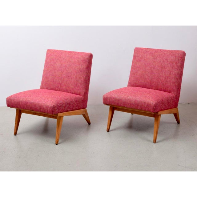 New upholstered pair of Jens Risom lounge chairs in a pinkish fabric. Condition is excellent.