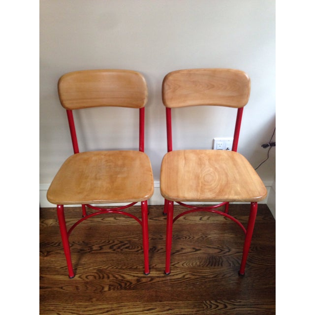 Set of (4) available, vintage Heywood Wakefield side chairs. Wood seat with metal legs. Original stamp at the bottom....