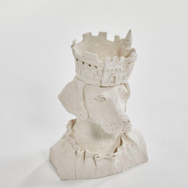 A dog sculpture with crown in plaster, originating in France, circa 2010.