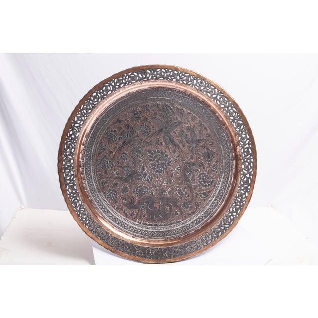 Tinned copper commemorative tray with pierced edge trim and a hand-tooled center. Inscribed with both Persian and English...