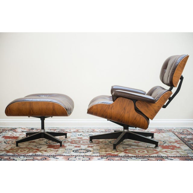 1976 Charles and Ray Eames 670 rosewood lounge chair and matching 671 ottoman manufactured by Herman Miller. Original...