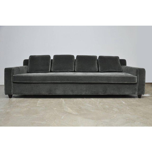 Early model sofa by Edward Worley for Dunbar. Classic design, fully restored in charcoal mohair. Beautiful espresso...