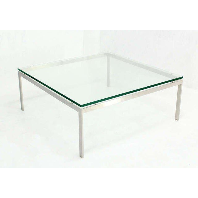 Very nice large square suspended glass top square coffee table.
