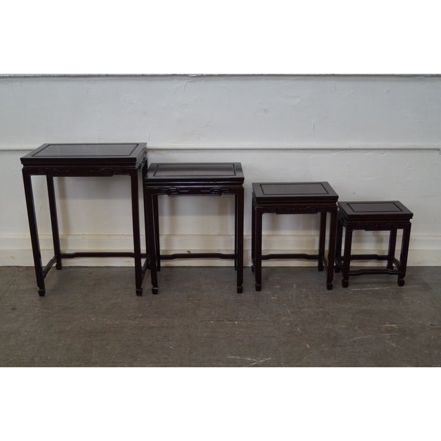 Set of four (4) Chinese rosewood nesting tables. AGE/COUNTRY OF ORIGIN: Approx 25 years, Asia DETAILS/DESCRIPTION: High...