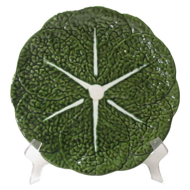 Large green majolica round platter with cabbage leaf motif. Backstamp of Belo Portugal. Minor glaze flaws,small underside...