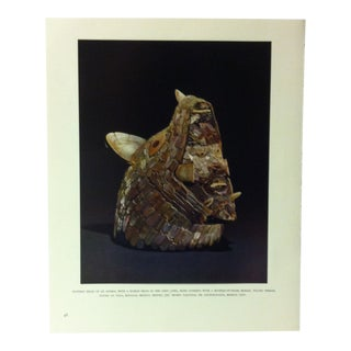 """Circa 1960 """"Pottery Head of an Animal With a Human Head in the Open Jaws"""" Treasures of Ancient America Mounted Print For Sale"""