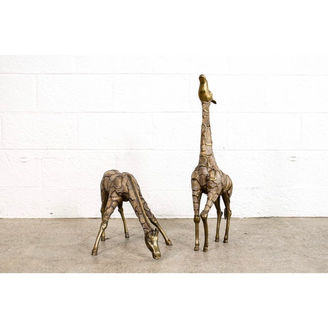 This pair of large vintage modernist solid brass floor statue giraffes are beautifully elegant. With gorgeous detailing...