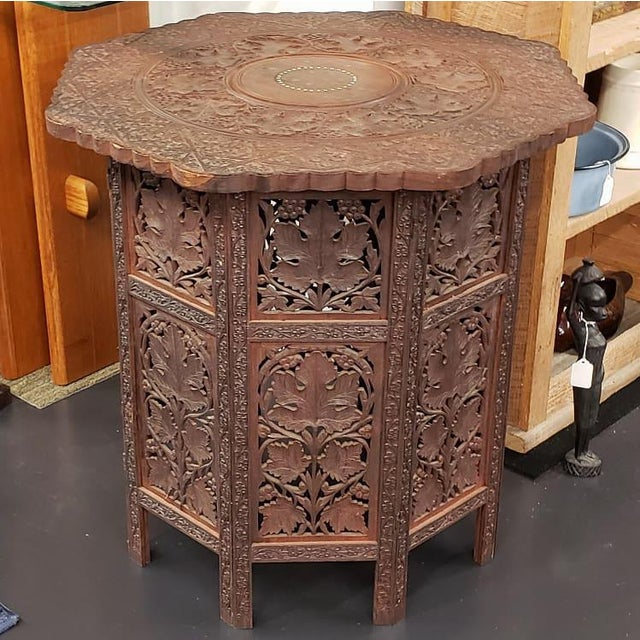 Circa 1900 Victorian Anglo-Indian Carved Padauk Wood/Brass Inlay Folding Octagonal Base Side Table For Sale In New Orleans - Image 6 of 6